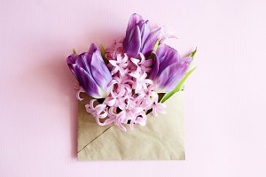 Tulip bouquet and envelope on white