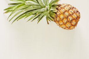 Summer concept Pineapple white wood