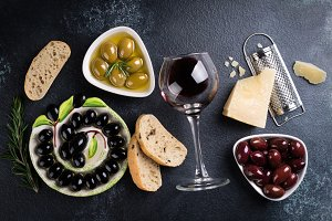 Red wine, olives, ciabatta, cheese