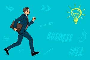 A businessman with a portfolio runs