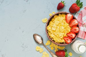 cornflakes, milk and strawberries