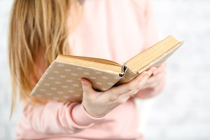 Female reading book, close up