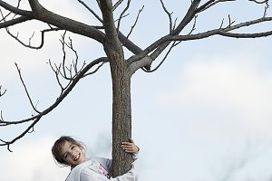 10-year-old girl climbing on a tree