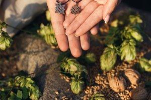 Svarog amulets in hands