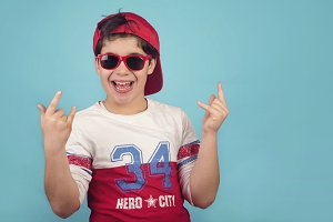 funny child with cap and sunglasses