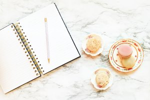 Desktop Macaroons and a notebook