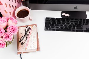 Pink styled desk office stock photo
