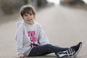 10-year-old girl sitting on floor