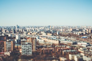 Tilt-shift cityscape with blue sky