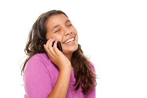 Happy Girl Using Cell Phone on White