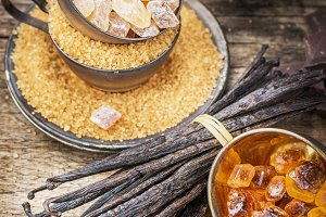 Brown sugar  on wooden background