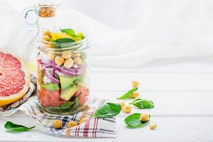 Delicious salad put into a jar for e
