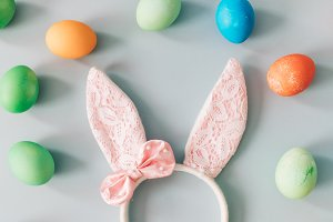 Bunny ears surrounded by Easter eggs