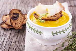 Thick pumpkin soup puree with smoked