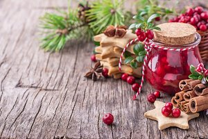 Cranberry sauce in a glass on wooden