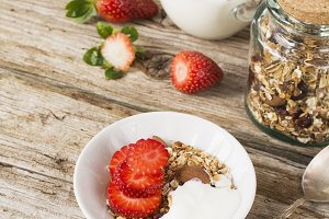 Bowl of healthy muesli with yogurt a