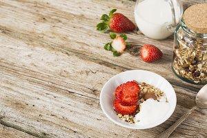Bowl of healthy muesli with yogurt a