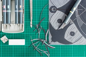 Lino cutting tools on a desktop.