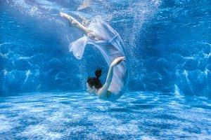 Woman dances under water.