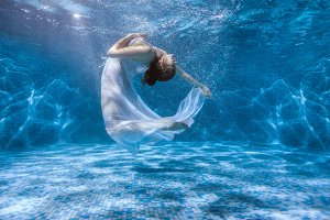 Dancing under the water.