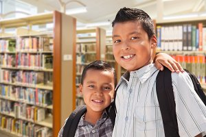 Brothers with Backpacks At Library