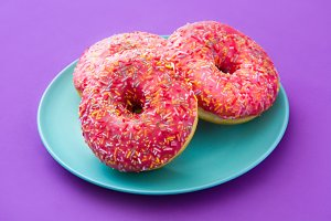 Pink frosted donut