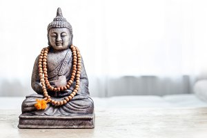 Buddha statue with beads