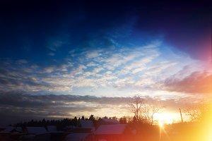 Dramatic sunset in village