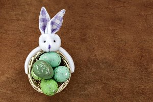 Green Easter Eggs In The Basket With