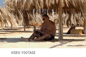 Relaxing on the beach with laptop