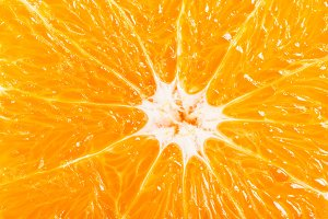 Slice of orange, macro, above view.