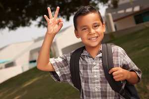 Hispanic Boy with Backpack at School