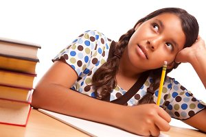 Hispanic Girl Studying on White