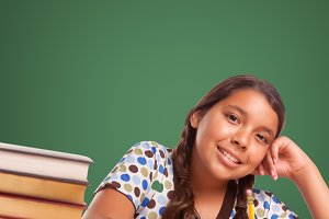 Cute Smiling Hispanic Girl Studying