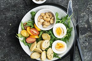 Fresh spring salad with boiled egg,