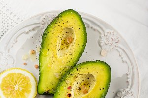 avocado halves with butter salt and