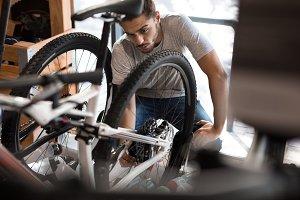 Mechanic assembling a bicycle