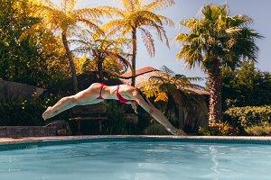 Woman in bikini diving