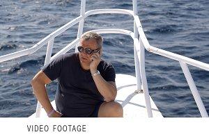 Phone talk on sailing yacht