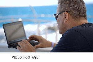 Using laptop during sea traveling