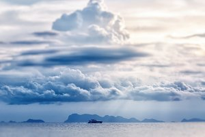 Boat in the sea and cloudly sky