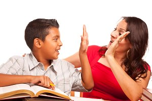 Hispanic Mother and Son Studying