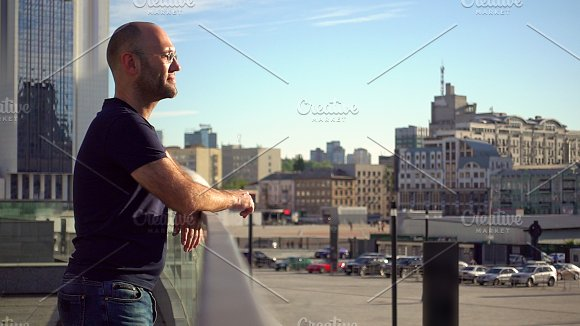 Handsome Man Is Standing On The Urban Balcony