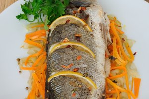 Baked trout on onion-carrot cushion