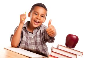 Student Boy at Desk with Thumbs Up