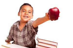 Hispanic Boy with Books Giving Apple