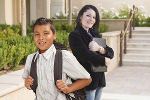 Boy with Backpack, Teacher Looks On