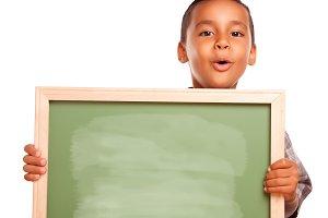 Latino Boy Holding Blank Chalkboard