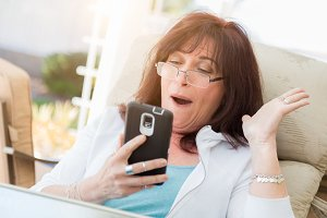 Middle Aged Woman Using Smart Phone