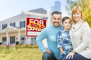 Family in Front of House & Sold Sign